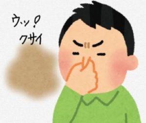 臭いと鼻をつまむ男
